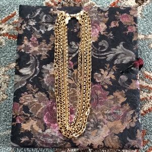 Stunning multiple strand gold toned necklace